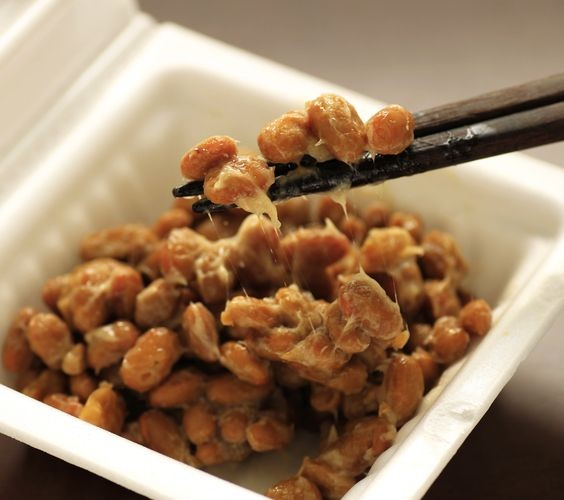 a container of natto(fermented soy beans) on the table